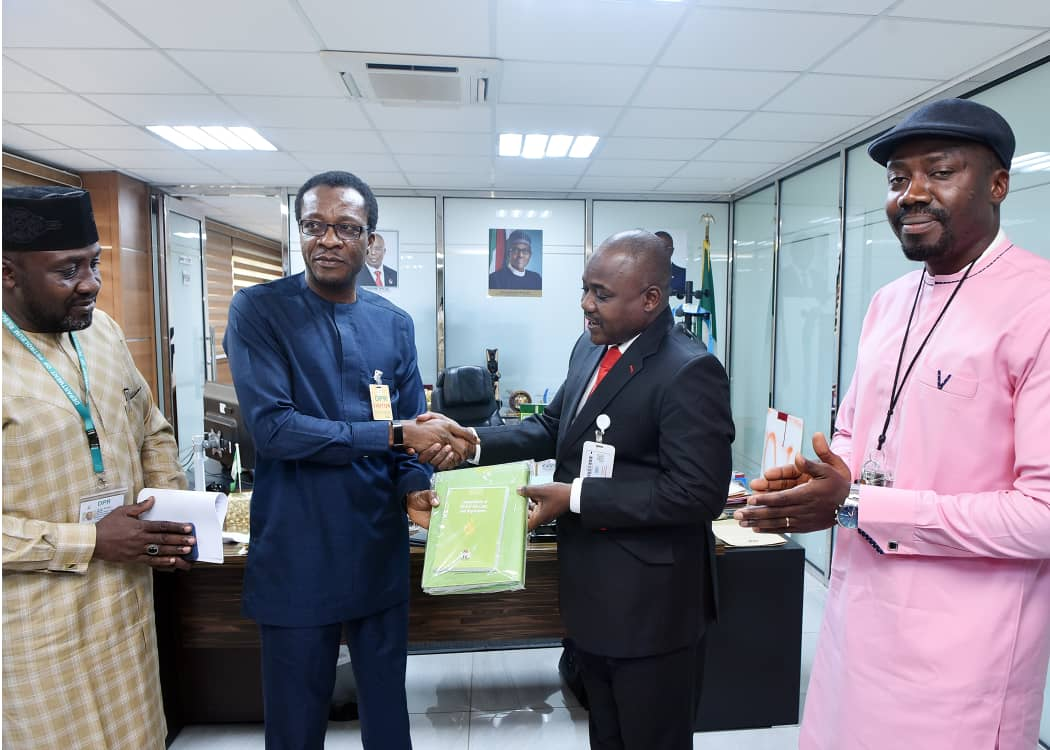 The Director of DPR, Sarki Auwalu presenting the Compendium of Laws in the Oil and Gas Industry to the President of PENGASSAN